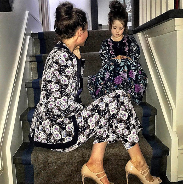 We love Jessica and Ivy's matching hairdos and perfectly paired floral outfits.