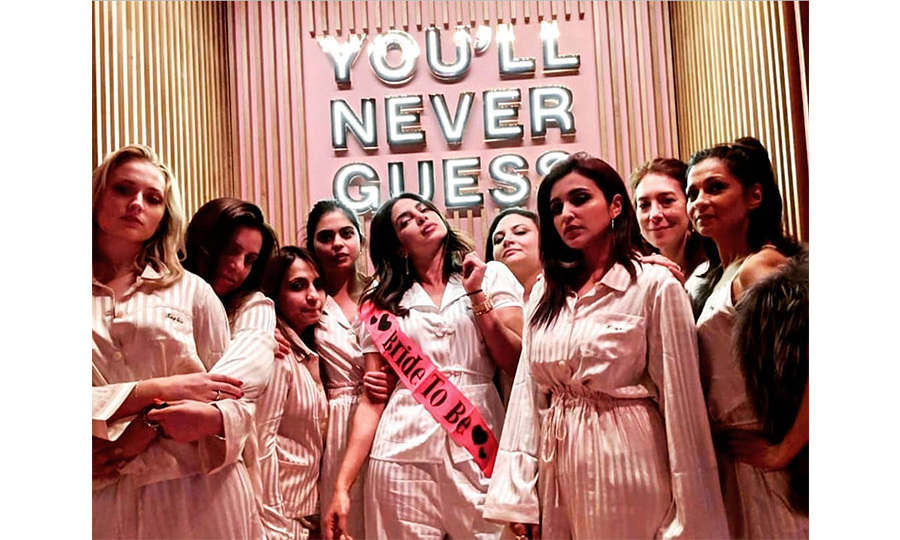 Priyanka Chopra's bachelorette gets cuter and cuter! The party posed in matching pink striped PJs as they continued the festivities in Amsterdam, with the bride-to-be decked out in a sash.