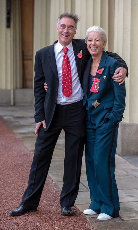 "Emma Thompson was all smiles on Nov. 7 as she posed with husband Greg Wise after her Investiture Ceremony, where the actress received her Damehood from Prince William. The 59-year-old got cheeky with the royal during the ceremony. ""I love Prince William, I've known him since he was little, and we just sniggered at each other,"" she shared. ""I said, 'I can't kiss you, can I?' And he said, 'No don't'!""