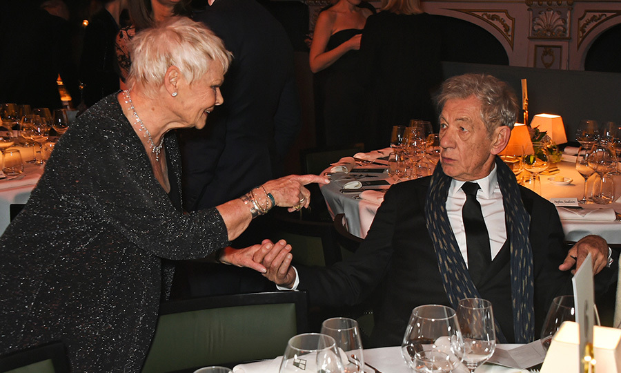 Dame Judi Dench and Sir Ian McKellen got up to no good at Buckingham Palace.