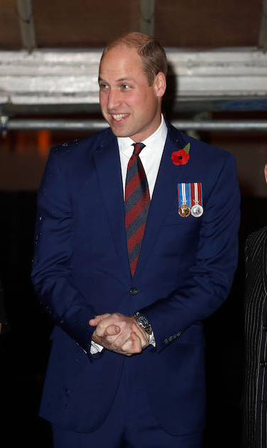 Prince William looked handsome in a blue suit and striped tie with his military medallions pinned to his jacket.