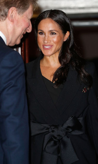 The duchess wore her hair in soft waves cascading over her shoulders and her skin bronzed to perfection with eyeliner accentuating her eyes and a pretty pink lip.
