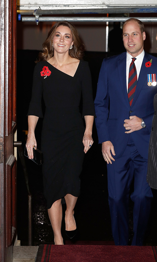 Kate wore a chic black dress with an asymmetrical neckline