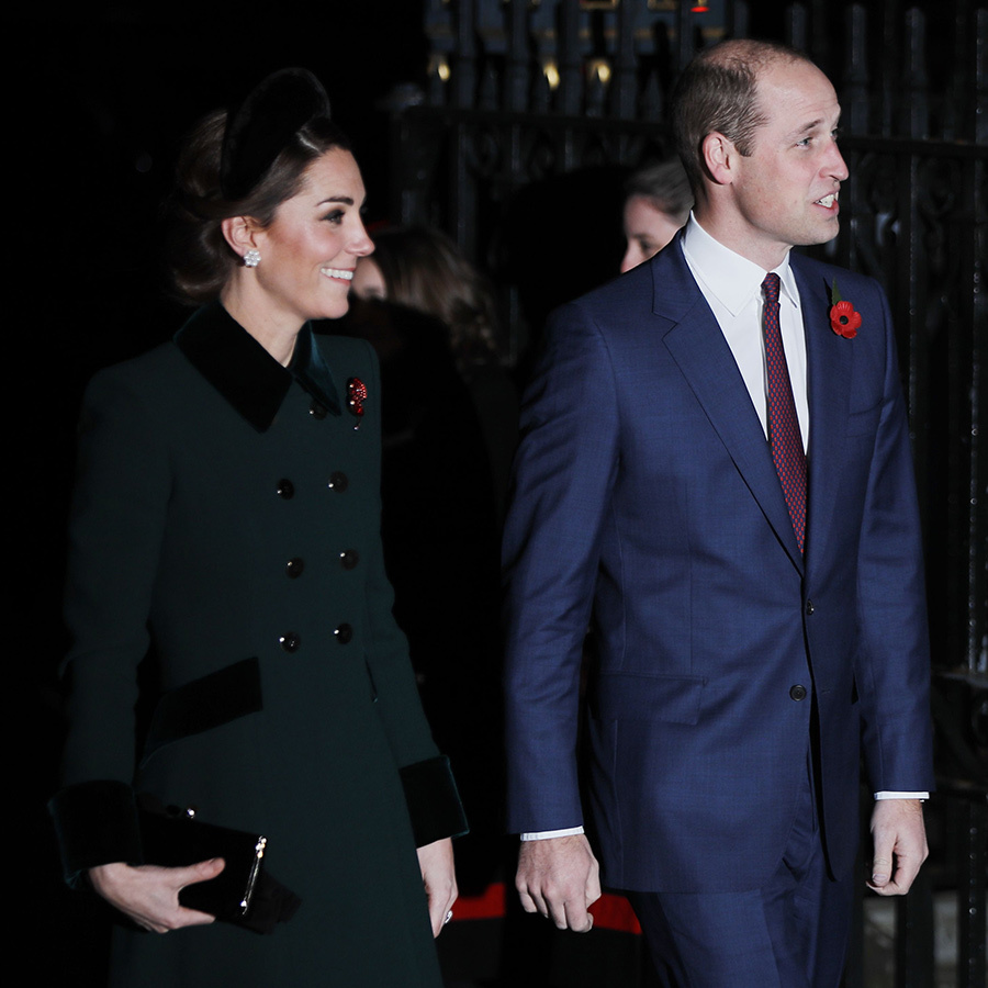 Kate looked gorgeous in a green double-breasted coat with velvet accents and carried a black clutch. Her husband donned a navy suit with a burgundy tie.