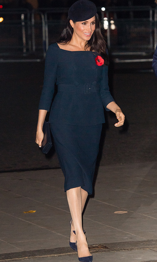 Meghan was the picture of Parisian chic at the Centenary of Armistice service on Remembrance Sunday, where she donned a double-breasted, belted ensemble with a peplum accent and a hemline just below the knee. She topped the look off with a jaunty beret and anchored it with navy pumps. The former actress carried a matching clutch and wore a bronzed makeup look with black liner accentuating her eyes. 