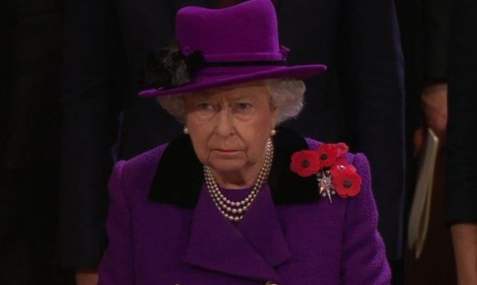 The Queen looked somber during the emotional service. 