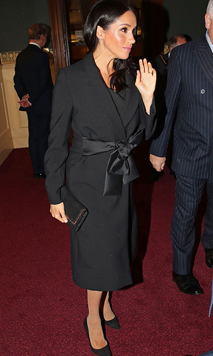 "While making her debut at the Royal Albert Hall on Nov. 10 for the Festival of Remembrance, Duchess Meghan recycled her Stella McCartney coat and faux leather Falabella bag by the same designer. She paired the look with her trusty Manolo Blahnik ""BB"" pumps in black and wore an off-shoulder sheath dress underneath.