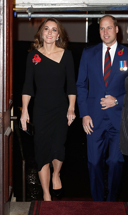 While stepping out for the Festival of Remembrance, Kate looked elegant as ever in a stunning Roland Mouret dress, boasting a unique asymmetrical neckline. She completed the look with a pair of black pumps and a matching clutch.