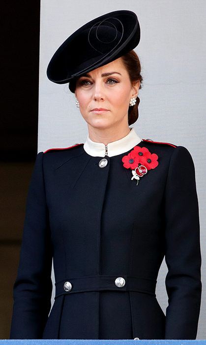 For Remembrance Sunday on Nov. 11, the Duchess of Cambridge looked no further than her favourite label, Alexander McQueen. She oozed cool in a military inspired coat with a white collar and red epaulets by the luxury designer paired with a chic black hat and floral pearl earrings.