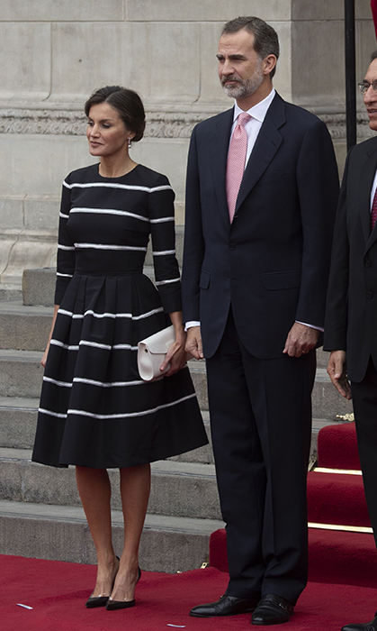 For a meeting with Peru's president Martin Vizcarra and first lady Maribel Diaz in Lima on Nov. 12, Queen Letizia donned a black-and-white striped dress with matching black heels and a chic chignon.