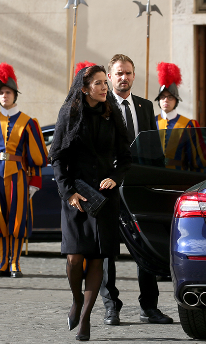 For a visit with Pope Francis in Vatican City on Nov. 8, Crown Princess Mary wore a chic black coat dress, black pumps and a lace veil over her hair.