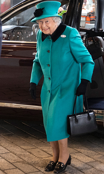 The Queen looked beautiful in teal while helping to open the new headquarters of Schroders in London on Nov. 7.