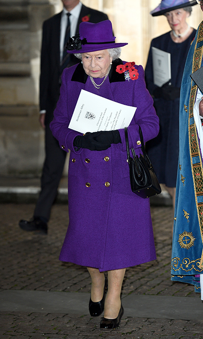 Queen Elizabeth II dazzled in a purple ensemble at the Centenary of the Armistice Service at Westminster Abbey on Nov. 11. She accessorized with a matching hat and five poppies pinned to her lapel with a silver and diamond brooch, believed to pay tribute to the five branches of service: army, navy, air force, civil defence and women.
