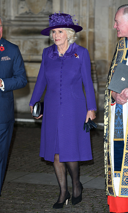 Camilla joined the Queen in wearing purple for the Armistice Service. The duchess stunned in a pretty coat dress, a matching hat and black heels.
