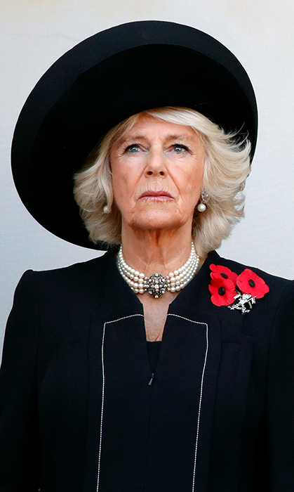 For the somber event, Duchess Camilla looked beautiful in a large black hat, a black coat with white piping and a beautiful four-strand pearl necklace with matching earrings.