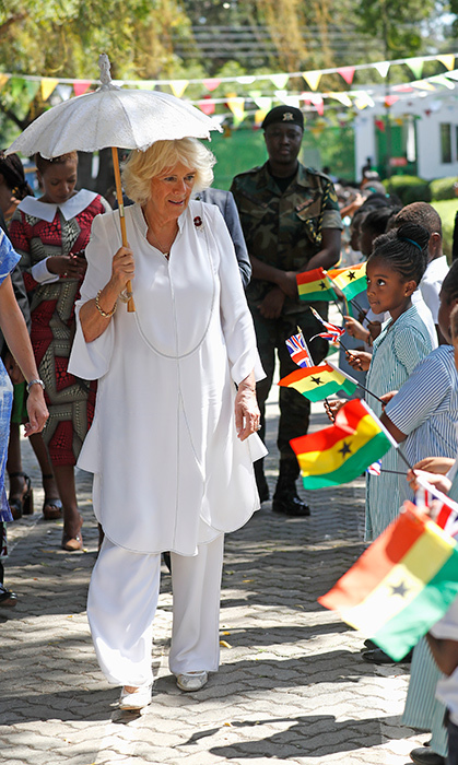 The Duchess of Cornwall looked fresh in an all-white outfit while greeting schoolchildren in Accra on Nov. 8.