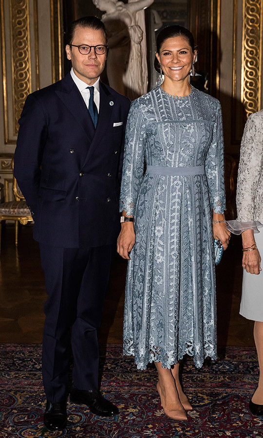 The future queen and her husband were dressed to impress as they welcomed the Italian leader and his daughter to Sweden on Tuesday at the Royal Palace. Princess Victoria wore a silver lace dress with a nipped waist and nude pumps, while Daniel looked dapper in a double-breasted navy suit. 