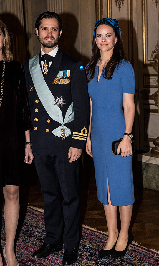 Princess Sofia took a page out of Duchess Kate's style book by pairing a cornflower blue dress with an oversized blue headband, finishing her look with black accessories as she stood with a decorated Prince Carl Philip.