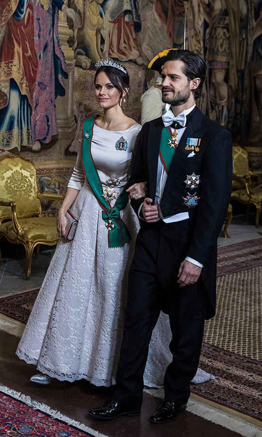 Princess Sofia was a vision at the gala honouring the president during his three-day visit. The mother of two wore a silver Zetterberg Couture gown with a lace skirt and three-quarter sleeves with matching shoes and clutch and a stunning diamond tiara. The Swedish royals also wore their Order of Merit of the Italian Republic in honour of their guests. 