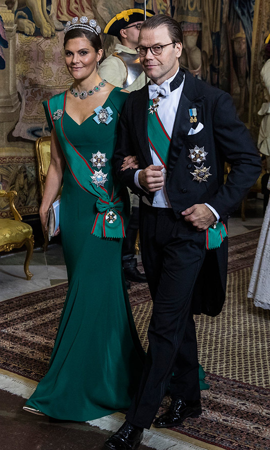 Crown Princess Victoria stole the show at a gala dinner honouring Italian President Sergio Mattarella and his daughter Laura, who are on an official visit to Sweden. The mother of two wowed in an emerald-green gown with peekaboo shoulder details and a small train, perfectly coordinated with her sash - a tribute to Italy. She frosted herself with a show-stopping emerald and diamond necklace and topped it all off with a stunning tiara. 