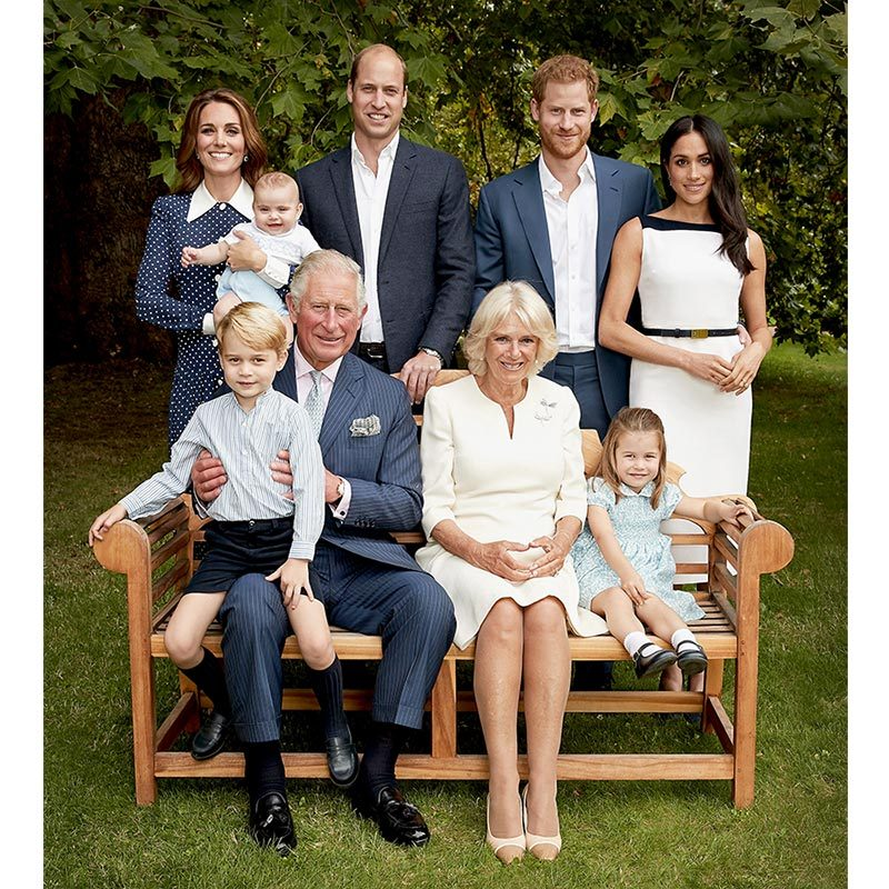 Prince Charles and Camilla posed with the Cambride family and Sussexes in a set of new birthday portraits, all clad in coordinated blue and white. Duchess Kate wore a pretty polka-dot number by Alessandra Rich while Meghan opted for a sleek belted Givenchy dress.
