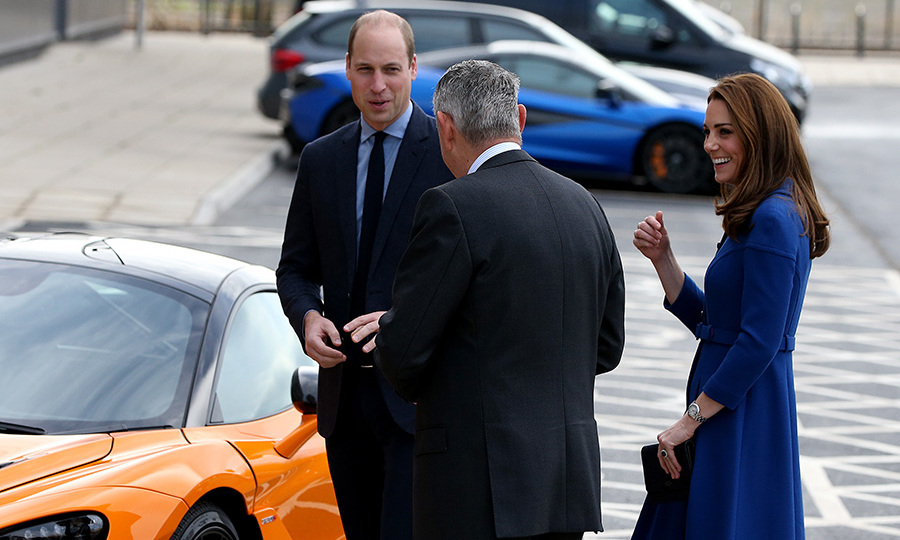 Kate had a giggle as the couple ogled an orange sports car. 