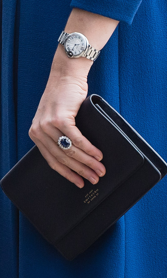 The duchess wore her Cartier Ballon Bleu watch and carried a smart clutch by Smythson.