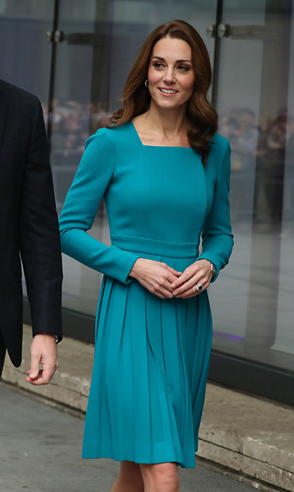 Kate's Cartier Ballon Bleu watch peeked out from under her sleeve and she wore a pair of gold and diamond Asprey hoops in her ears.