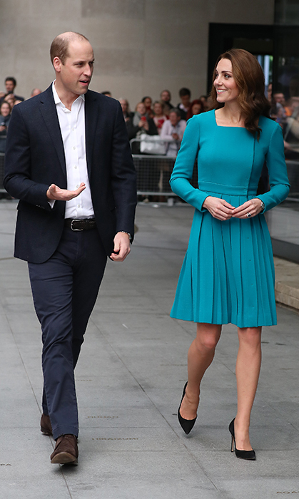 The couple chatted happily as they entered the building. Prince William looked dapper in a simple suit jacket and trousers, brown shoes and a white button-up.
