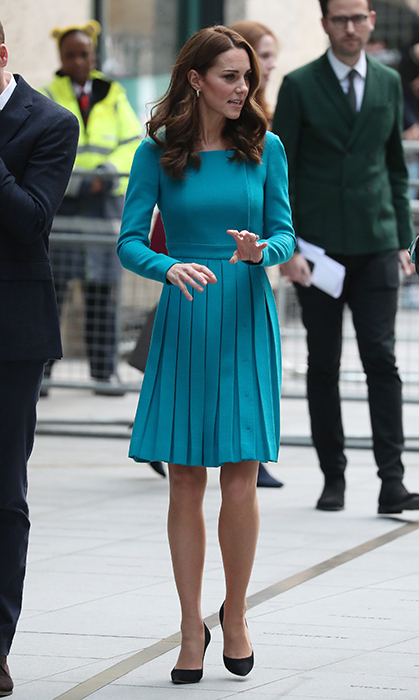 The duchess dazzled in a jewel-toned pleated Emilia Wickstead dress, which featured a pretty square neckline and pleated skirt.