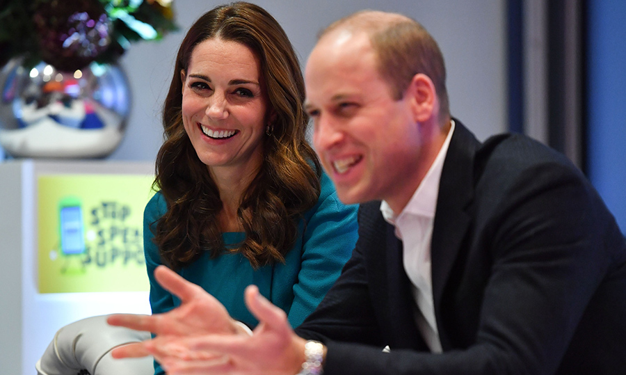 Those looks of love! The duchess laughed as her husband gestured enthusiastically while chatting to a group of youths.