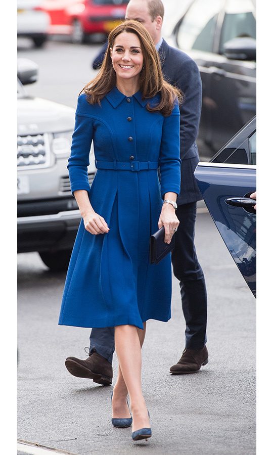 The Duchess of Cambridge spent the morning of Prince Charles' birthday in South Yorkshire with Prince William, where she recycled a pretty blue coat dress by Eponine London featuring structured shoulders, a buttoned-up collar, a belt and a pleated skirt. Kate paired the dress with suede navy pumps, a Smythson clutch, her Cartier Ballon Bleu watch and Princess Diana's diamond and sapphire earrings.