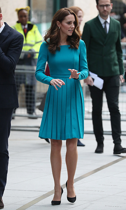 Another royal rewear! On Nov. 15, the Cambridges made a poignant visit to the BBC to talk about cyberbullying. Looking bright and cheery after a night of celebration at Prince Charles' birthday party, Kate slipped into an Emilia Wickstead dress with a pleated skirt that she last wore while on royal tour in New Zealand. She anchored the look with black pumps and topped it off with soft waves and Asprey London hoop earrings.