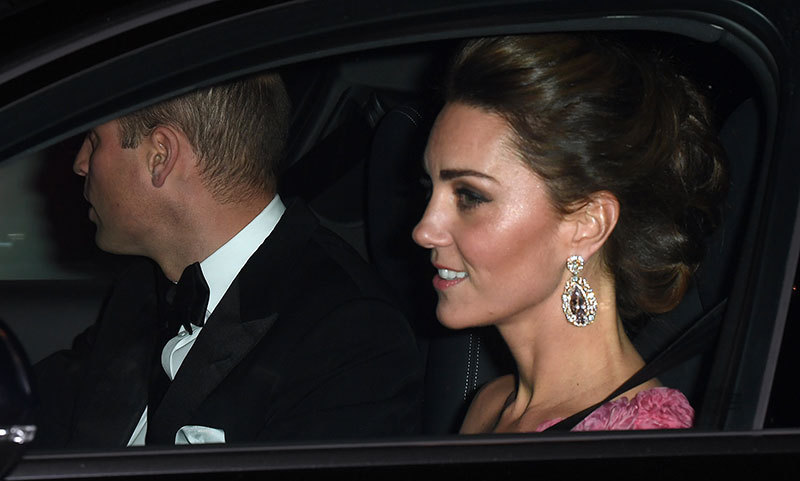 While we didn't get to see the full look, Kate made quite the entrance on Nov. 14 as she and William arrived at Buckingham Palace for the Queen's special gala in honour of Prince Charles. Kate had her locks in an elegant and intricate updo to show off her oversized drop earrings (first worn in 2011 at a women's event and again in 2017 at the BAFTAs), and wore a pretty one-shoulder pink gown with floral embellishments. 