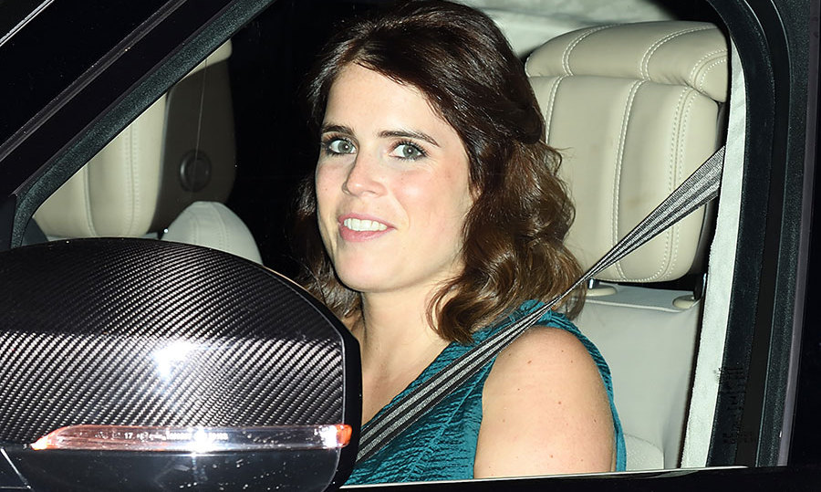 Newlywed Princess Eugenie arrived at the Palace with her hubby Jack Brooksbank looking gorgeous in a teal Roland Mouret draped gown with asymmetrical straps and her brown hair in soft waves. 