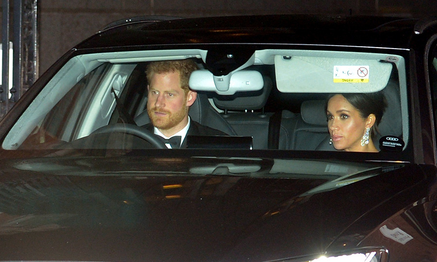 If Duchess Meghan's glittering chandelier earrings looked familiar as she arrived at Buckingham Palace on Nov. 14 with Prince Harry, that's because they are - the royal wore the dazzling jewels to a formal dinner in Fiji while the couple was on tour in October. Though they were revealed to be on loan, there's still no word on who she borrowed them from! The pregnant royal had a pregnancy glow that was just as striking, with her bronzed skin perfectly paired with a smoky eye and pink lip, and she wore her hair in a tidy chignon.