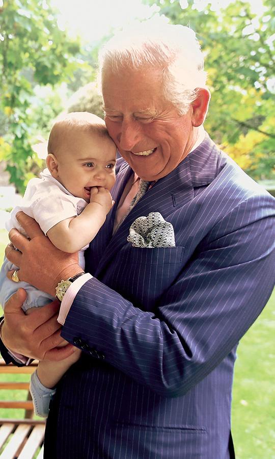 "Prince Louis melted hearts around the world in this sweet snap with his grandpa, who looks positively ecstatic to be sharing this special moment. The beaming baby has his little fingers in his mouth as he sits contentedly in Charles' arms. ""It was lovely chaos with the children,"" revealed Chris Jackson. ""He is a very hands-on grandfather. He was holding hands with George and Charlotte, and bouncing Louis up and down for a long time. George was very happy on the Prince's knee. They have a great relationship that's a little more established, as George is a bit older.""