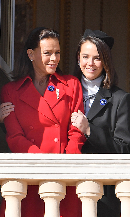 Princess Stephanie and her daughter Pauline Ducruet had a sweet mother-daughter moment while posing on the balcony. Pauline wore a chic hat and avant-garde blouse while her mom looked radiant in a red suit and simple black headband.