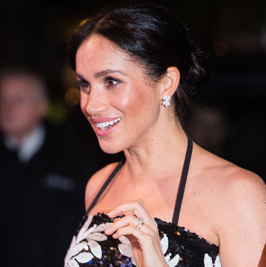 The Duchess of Sussex's tidy bun with face-framing tendrils showed off her Birks Snowflake Snowstorm diamond earrings, a favourite evening accessory for the royal. Once again, her glowing skin was front and centre alongside a smoky eye and pink lip. 