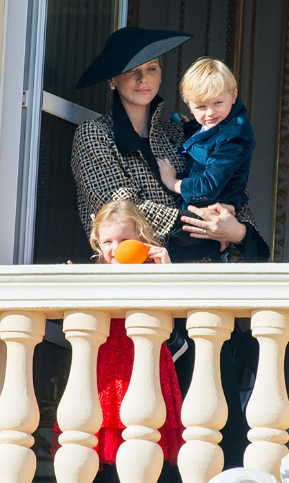 The three-year-old played with an orange balloon while her mom held her smartly dressed twin Jacques. Gabriella had a bow in her blond locks, which sh paired with a lacy red dress with a crinoline skirt, while her brother wore a blue velvet blazer.