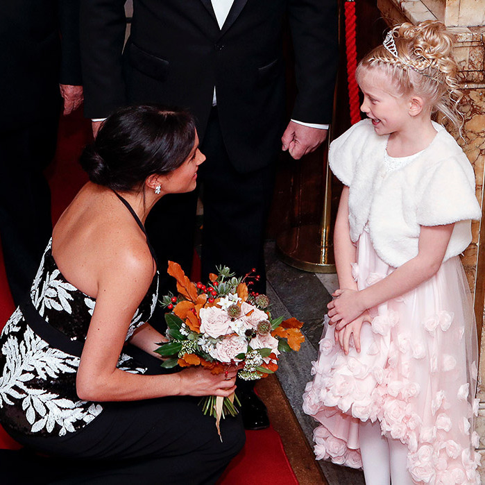 Meghan was given a beautiful bouquet by seven-year-old Darcie-Rae Moyse, also dressed in a floral-embellished design, plus a furry white jacket. She topped it all off with the perfect accessory: a tiara! The bouquet included Westminster Abbey roses, viburnum, white thistle, narcissus and autumn beech.