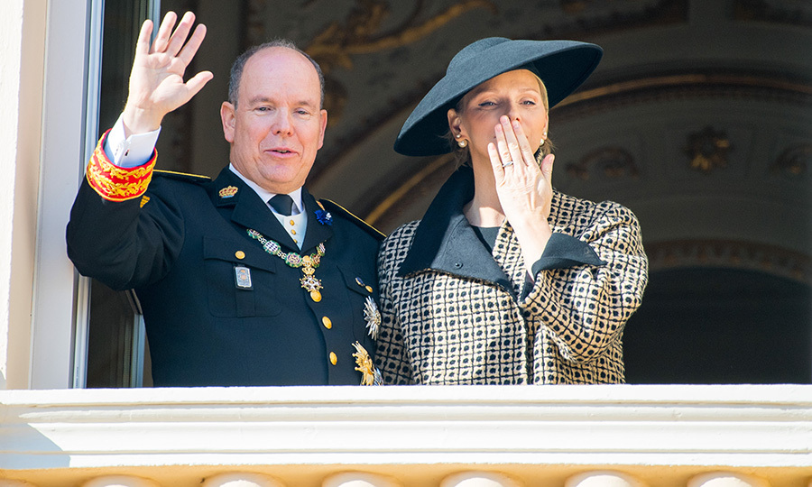 The prince wore his military uniform while his former Olympian wife wore a patterned coat, sleek black hat and pearl Dior earrings. 