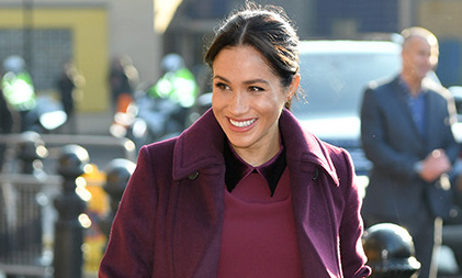 57a6b5da90748 Duchess Meghan wears a burgundy outfit by a go-to brand to visit the Hubb  Community Kitchen