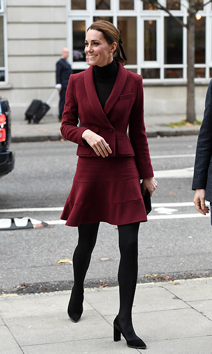 Duchess Kate channeled her inner elegant academic in a recycled Paule Ka skirt suit and a black turtleneck underneath. The monochrome maroon look, which was almost identical in hue to Duchess Meghan's outfit on the same day, suited her perfectly for a visit to a college. 