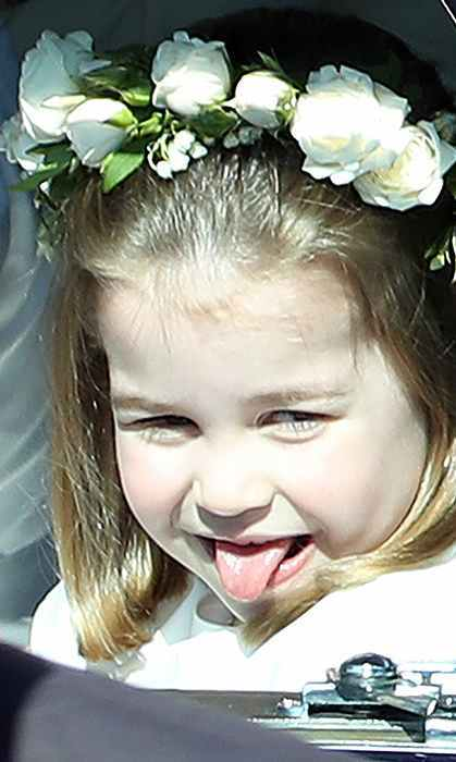 Charlotte really is taking after her big brother (and cheeky Uncle Harry!). The little bridesmaid stuck her tongue out at crowds while leaving St. George's Chapel after watching Meghan and Harry exchange vows.