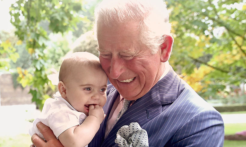 Another portrait showed Prince Charles relishing in his role as grandpa! His newest grandson, Prince Louis, looked delighted in his arms, smiling brightly and chewing on his hand.