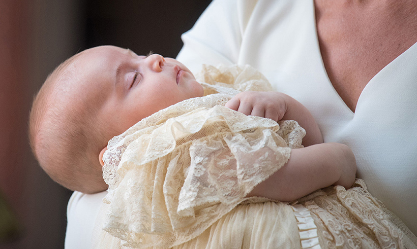 Prince Louis was christened on the afternoon of July 9 and the adorable two-month-old dozed in his doting mother's arms. 