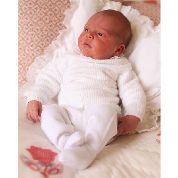 Louis looked absolutely adorable in his first portraits as a newborn baby, released on May 5 and taken on May 2, his big sister's birthday. Looking very alert at just nine days old, the little one wore a hand-me-down outfit by Spanish label Irulea as he lounged at the Cambridges' London home.