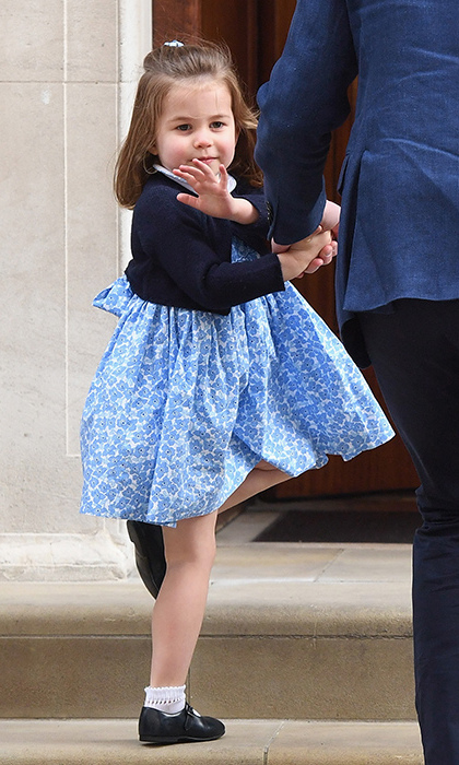 The sweet princess offered one of her signature waves to the crowd before heading into the luxe wing to see her mom and meet her little brother for the first time.