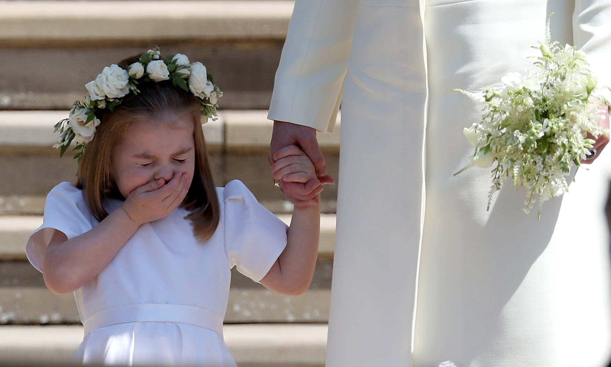 Bless you! Princess Charlotte was captured mid-sneeze while standing on the West Steps at Prince Harry and Meghan's royal wedding in May.